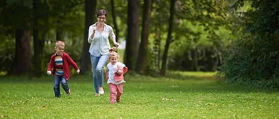 happy family playing together outdoor  in park mother with kids  running on grass.jpg