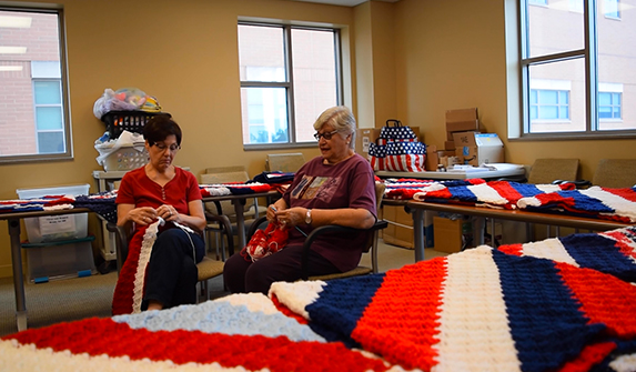 Photo of Lake Health volunteers Iris and Susan crafting blankets to donate to hospitalized veterans