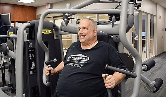 Image of Larry Using Exercise Equiptment Inside LiveHealthy Fitness Center
