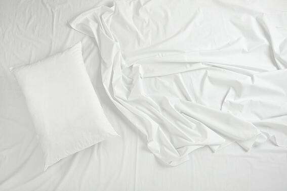 close up of bedding sheets and pillow.jpeg