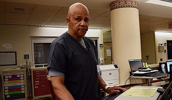 Photo of Emergency Room Triage Tech Shelton Jones, standing by Nurses Station